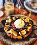 Fresh Fruit Waffle ($8), Muddy Espresso ($5)