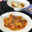 Ravioli Handmade Porcini, mushroom stuffed ravioli with marinara sauce.