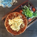 Savoury waffles for the afternoon: truffled scrambled eggs on waffles.