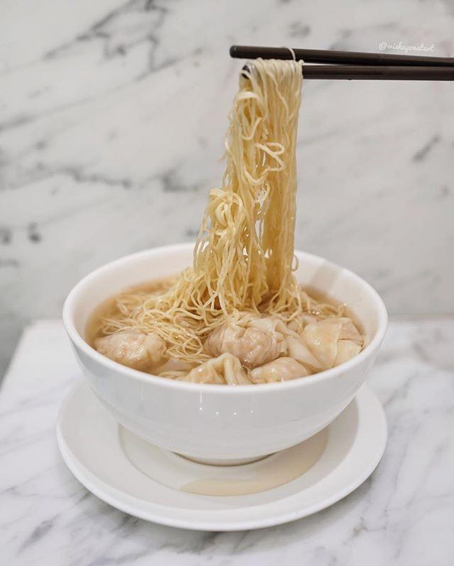 Slurping a bowl of (one starred michelin) wanton mee (HKD 54).