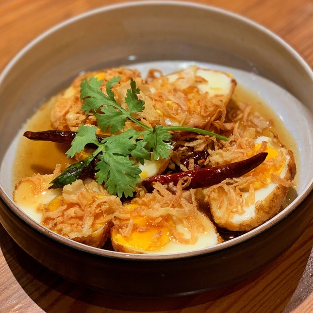 Fried boiled eggs with tamarind sauce