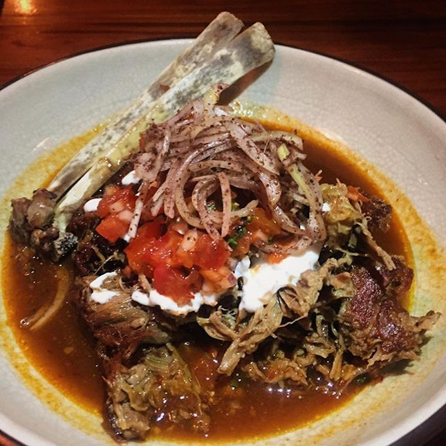 Slow roasted lamb shoulder, with toum garlic sauce, tomato ezme and dirty onions.