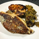 Grilled grouper, cured with salted eggs, served with grilled vegetables tossed with a laksa leaf pesto