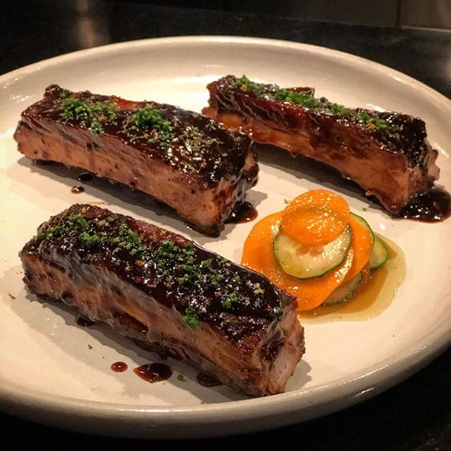 Pork ribs that are so tender and juicy smothered with a medjool dates paste, paired with carrot and cucumber pickles.