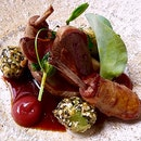 Pigeon breast & confit leg, rhubarb & rose puree, grapes 'a la Aussignac'