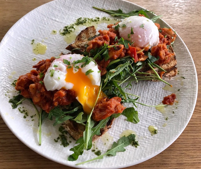 Bacon baked beans with arugula & poached eggs on herb rye sourdough  $26