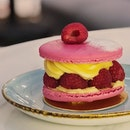 Raspberry and lychee macaron ($7.80)  Raspberries, lychee rose petal buttercream, topped off with 2 macarons shells.