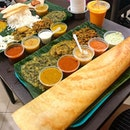 Paper dosa and rice meal.