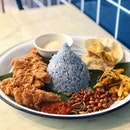 Nasi lemak with prawn paste chicken, served with blue coconut rice stained with butterfly pea flower dye which was fluffy and light, with a slight coconut flavour.