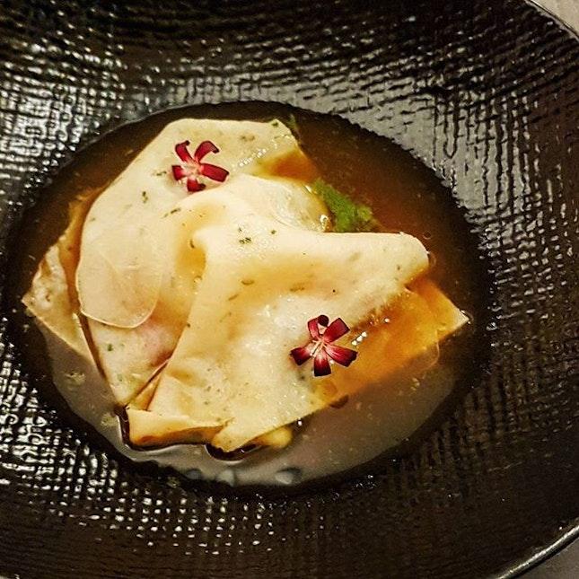 Sinigang sa Sampalok: carabinero prawns made into pasta in a tart shellfish broth with edible flowers...