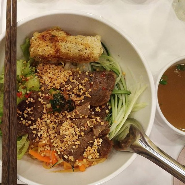 Dry Rice Vermicelli with Grilled Beef and Spring Roll ($9.90) .