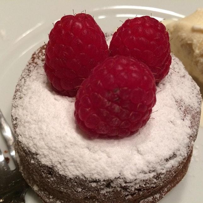 Chocolate lava cake w fresh raspberries and vanilla icecream #dinner at home