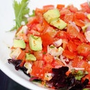 Vibrant and refreshing salad that consists of tomatoes, shrimp and avocado.