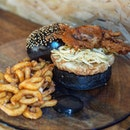 [Paddy Hills] - The Soft Shell Crab Burger ($25) comes in a crispy prawn patty and soft shell crab sandwiched in between two fluffy squid ink buns.
