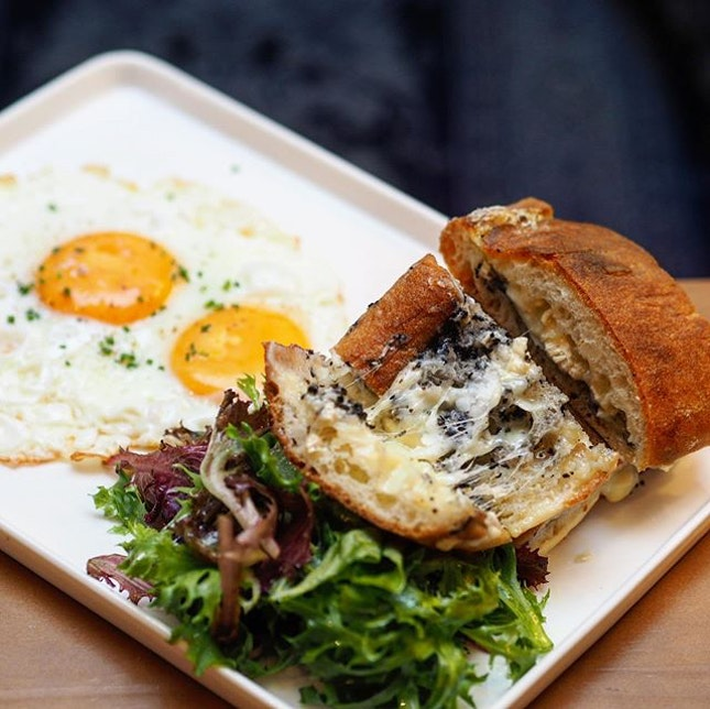 [Antoinette] - Schiacciata ($18), a traditional flatbread stuffed with melted camembert, pecorino and a rich truffle aroma.