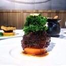 [Wok Palace] - Braised Beef Cheek with Organic Kale and Confit Tomato ($28).