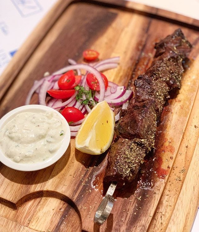 short rib steak, served medium rare.