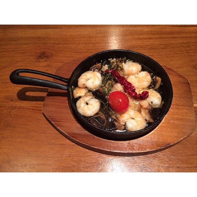 Prawns and mushrooms cooked in olive oil and garlic in a pan #burpple
