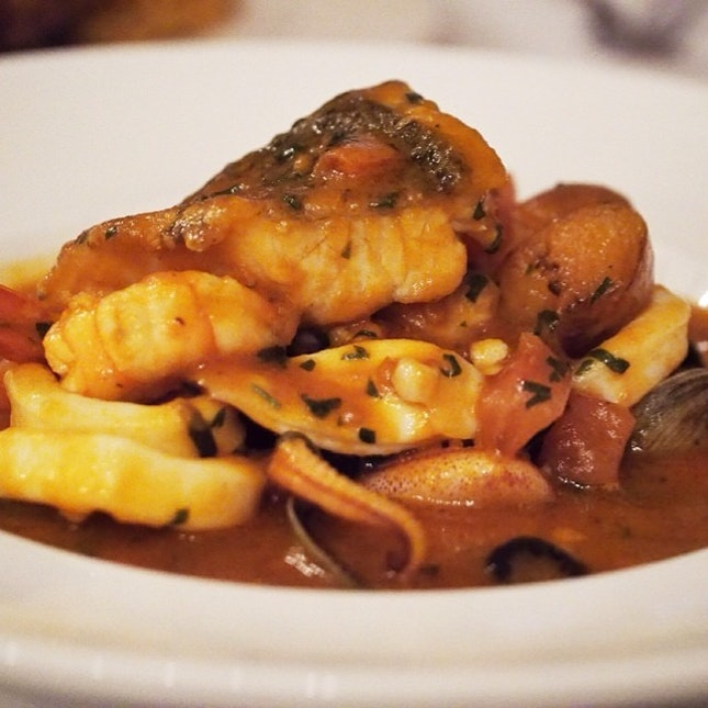Fish, prawns, calamari and clam stew in tomato sauce #burpple #seafood #olympus #italian