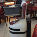 So robots are being deployed to help collect crockery and cutlery from dining guests.