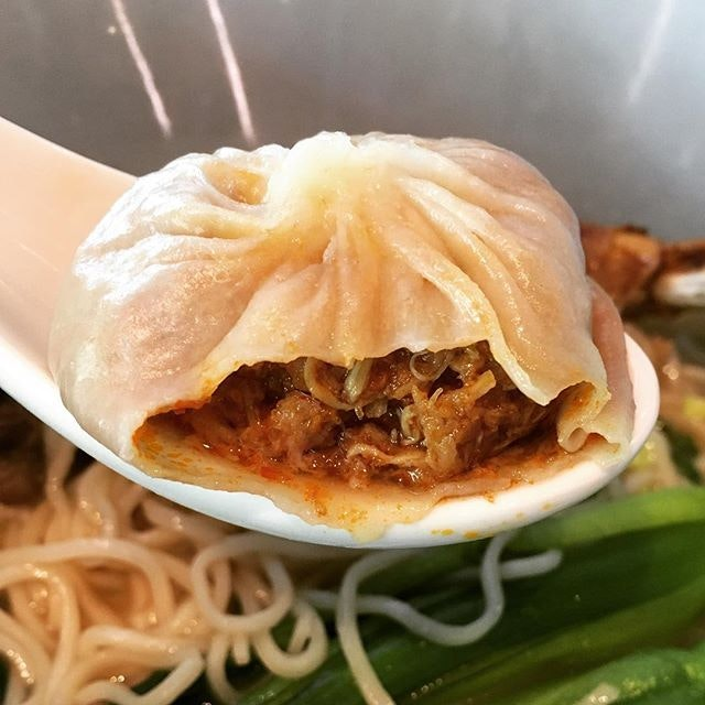Chili Pomelo Crabmeat and minced pork xiao long bao ($9 for 4 pieces) in an elegant oriental setting.
