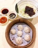 Shanghai Xiao Long Bao ($4.50/6 pieces), Beijing Zha Jiang Mian ($3.50).