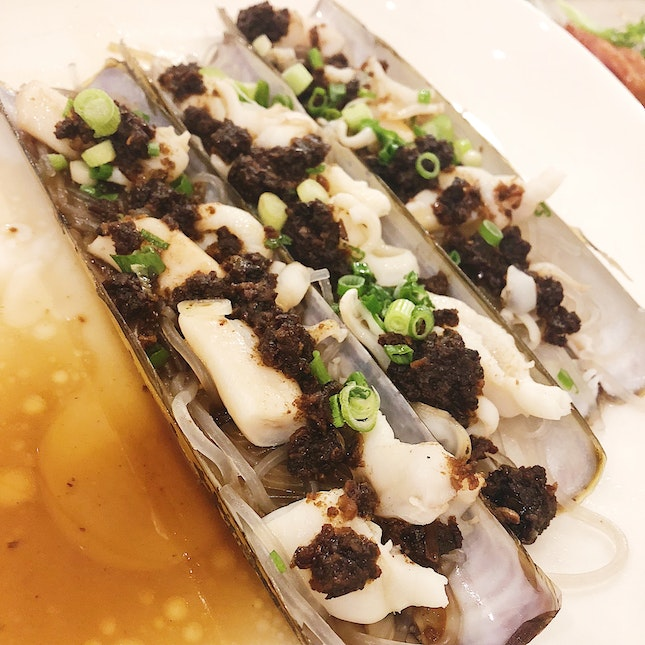 Steamed Scottish Razor Clam in Korean Black Garlic ($12/piece)