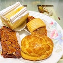 Apple Aloe Vera Cake ($2.50), Pineapple Tart ($2), Custard Cream Puff ($2), Florentine Cookie Bar ($2).
