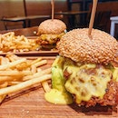 Salted Egg Chicken Burger ($14), Lemak Curry Burger ($14).