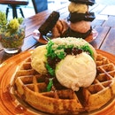 Nonya chendol waffle ($13.90), strawberry cream with charcoal waffle ($14.90).