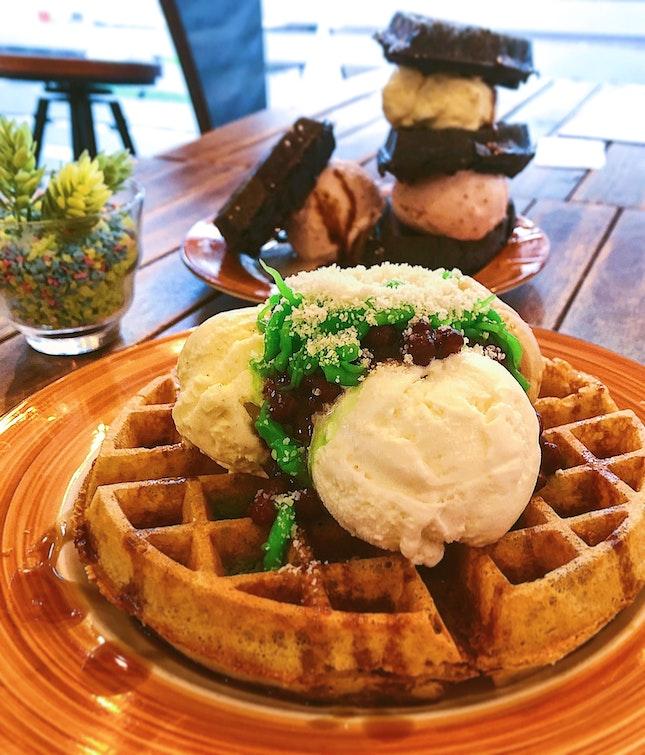 Nonya chendol waffle ($13.90), strawberry cream with charcoal waffle ($14.90).