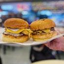 Classic Cheeseburger ($10), Fish Burger ($10).