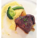 Fork-tender, red wine-drenched beef cheek with mashed potatoes and the obligatory broccoli floret and sugar snap pea.