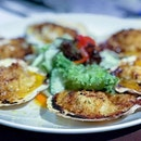 Gratinated scallops with too much garlic...love served on a platter.