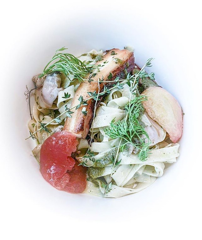 Grilled octopus, meaty clams, charred tomatoes, al dente fettuccine...just some of my favourite things.