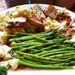 Potatoes salad with smoked chicken and asparagus.